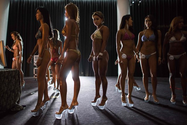 Female bodybuilders prepare to compete in the 'Miss Bikini' category of the NABA/WFF Asia-Seoul Open Championship in Seoul on April 17, 2016. (Photo by Ed Jones/AFP Photo)