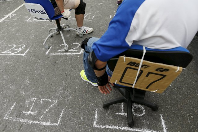 Competitors wait for the start of the office chair race ISU-1 Grand Prix in Tainan, southern Taiwan April 24, 2016. (Photo by Tyrone Siu/Reuters)
