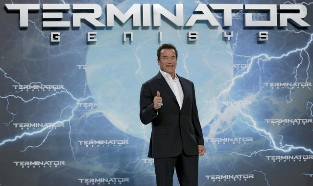 Arnold Schwarzenegger gives a thumbs up as he arrives for the Europe premiere of his new movie 'Terminator: Genisys' in Berlin, Germany, Sunday, June 21, 2015. (AP Photo/Michael Sohn)