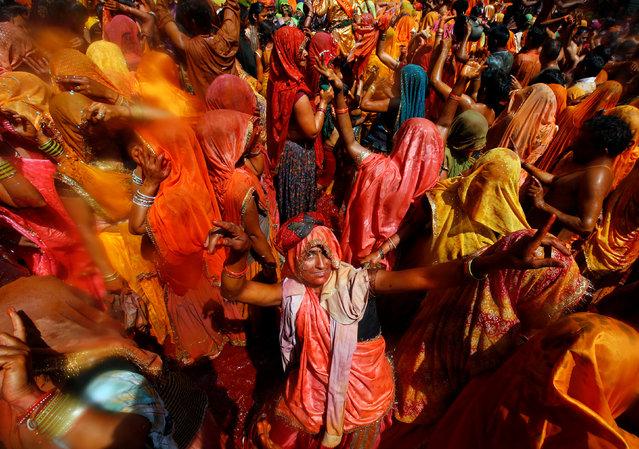 "A woman dances during ""Huranga"", a game played between men and women a day after Holi, at Dauji temple near Mathura, March 14, 2017. (Photo by Adnan Abidi/Reuters)"
