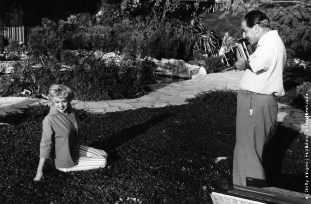 American film star Marilyn Monroe (1926  - 1962) being photographed by Baron in Palm Springs, 1954