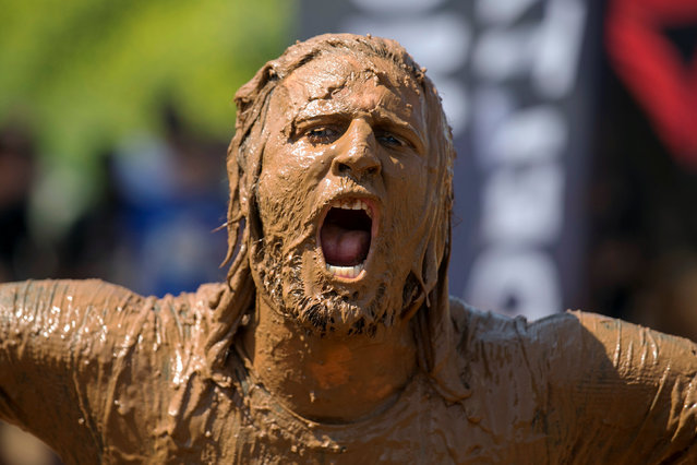 A participant takes part in the first Mud Day Israel obstacle course race in Tel Aviv, Israel March 24, 2017. (Photo by Baz Ratner/Reuters)