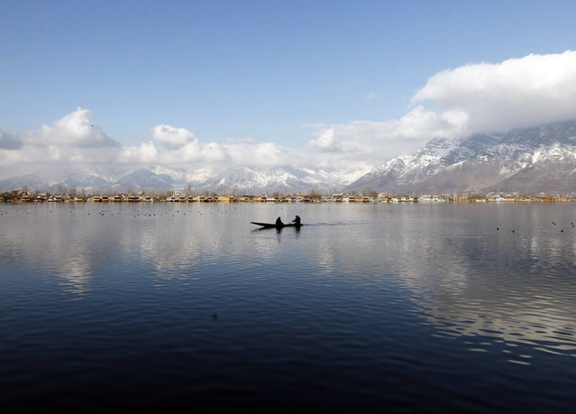 A man rows a small boat on the waters of Dal Lake on a sunny day in Srinagar February 4, 2015. (Photo by Danish Ismail/Reuters)