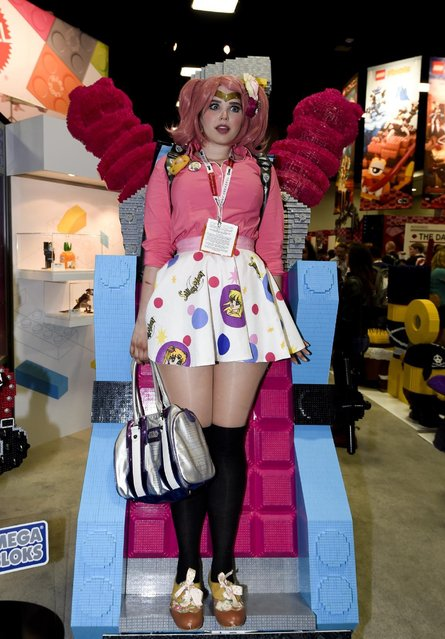 Katherine Dresser poses in a Mega Bloks display on Preview Night at the 2015 Comic-Con International held at the San Diego Convention Center Wednesday, July 8, 2015, in San Diego. (Photo by Denis Poroy/Invision/AP Photo)