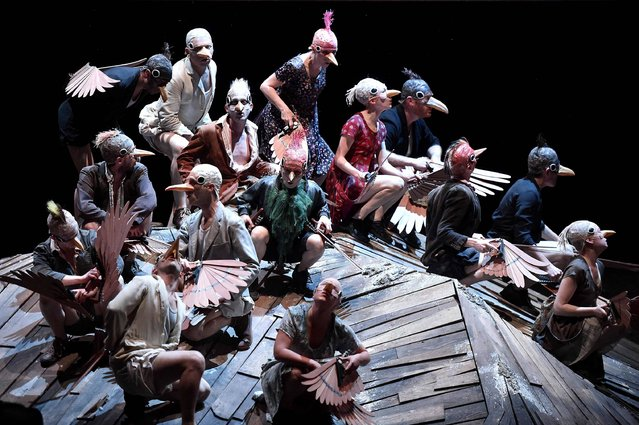 """Actors perform during a rehearsal of the ancient Greek piece """"Les oiseaux"""" (The birds) by Aristophane on April 14, 2017 at the National Theatre of Toulouse, southern France. (Photo by Remy Gabalda/AFP Photo)"""