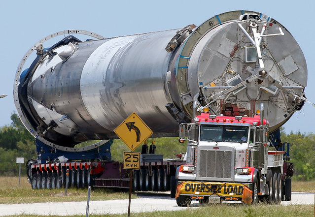The recovered first stage of a  SpaceX Falcon 9 rocket is transported to the SpaceX hangar at launch pad 39A at the Kennedy Space Center in Cape Canaveral, Florida May 14, 2016. The vehicle was launched on May 6 and returned to land a short time later aboard a barge in the Atlantic Ocean. (Photo by Joe Skipper/Reuters)