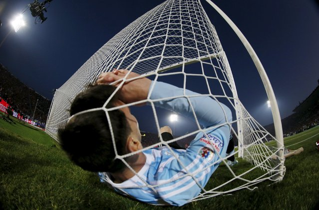 Argentina's Lionel Messi falls in the net during the Copa America 2015 final soccer match against Chile at the National Stadium in Santiago, Chile, in this July 4, 2015 file photo. (Photo by Ivan Alvarado/Reuters)