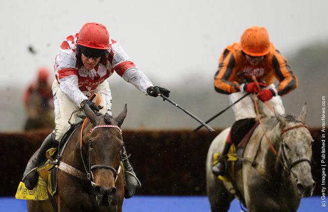 Barry Geraghty (L) riding Riverside Theatre clears the last to win The Betfair Ascot Steeple Chase from Medermit (R) at Ascot racecourse in Ascot, England