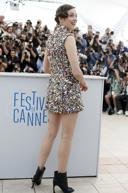 Actress Marion Cotillard poses for a photographers during a photo call for Two Days, One Night (Deux jours, une nuit) at the 67th international film festival, Cannes, southern France, Tuesday, May 20, 2014. (Photo by Alastair Grant/AP Photo)
