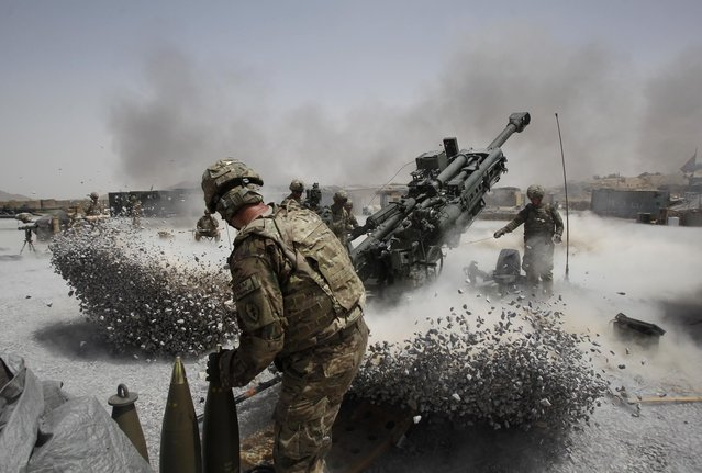 U.S. Army soldiers from the 2nd Platoon, B battery 2-8 field artillery, fire a howitzer artillery piece at Seprwan Ghar forward fire base in Panjwai district, Kandahar province southern Afghanistan, June 12, 2011. (Photo by Baz Ratner/Reuters)