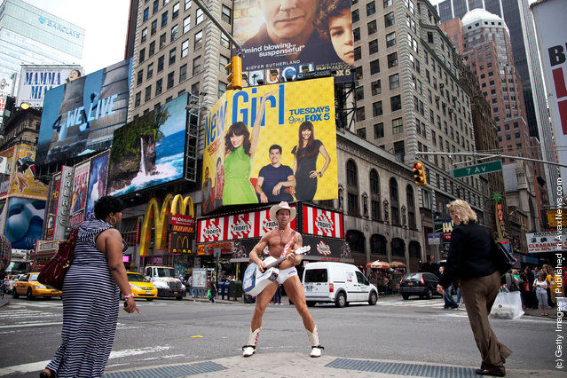 The 'Naked Cowboy' plays his guitar in Times Square on March 23, 2012 in New York City