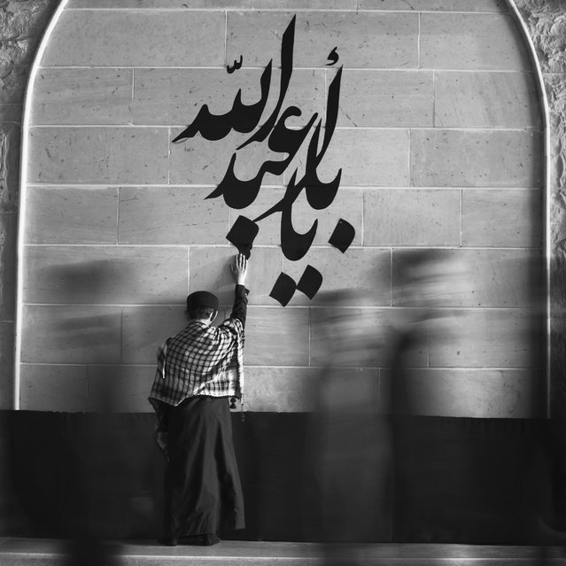 """""""Faith"""". The words on the wall: """"Abdullah's Father"""". It is the nickname of the """"Imam Hussein"""" which was the Muslims' prophet's grandson. Imam Hussein was murdered with his baby """"Abdullah"""" in a fight trying to deliver a great message 1400 years ago. It is a very sad story. However, that story became a big yearly occasion for a huge part of the muslims which are called """"Shia"""". Photo location: Hufuf, Saudi Arabia. (Photo and caption by Mohammed Baqer/National Geographic Photo Contest)"""