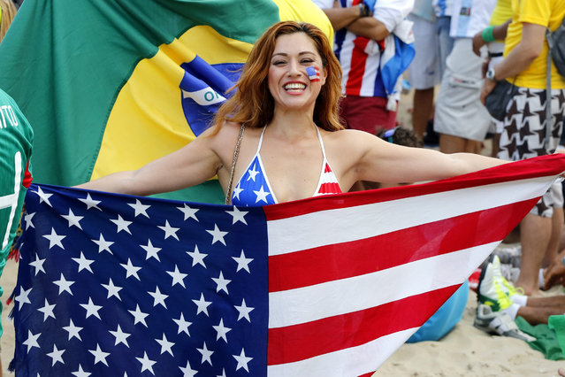 A US soccer fan cheers during the FIFA World Cup 2014 group A preliminary round match between Brazil and Croatia at the FIFA Fan Fest in Copacabana, Rio de Janeiro, Brazil, 12 June 2014. Brazil won 3-1. The FIFA World Cup 2014 will take place in Brazil from 12 June to 13 July 2014. (Photo by Abedin Taherkenareh/EPA)