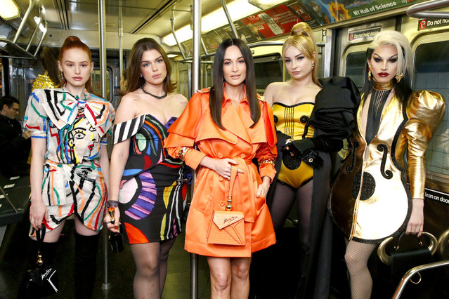 (L-R) Madelaine Petsch, Julia Fox, Kacey Musgraves, Kim Petras and Aquaria attend the Moschino Prefall 2020 Runway Show front row at New York Transit Museum on December 09, 2019 in Brooklyn City. (Photo by Astrid Stawiarz/Getty Images for Moschino)