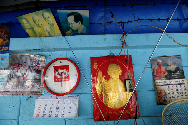 Pictures of Thailand's King Bhumibol Adulyadej hang on a wall of a street food stall in Bangkok, Thailand, June 4, 2016. (Photo by Jorge Silva/Reuters)