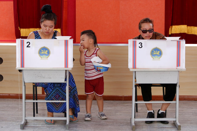 People vote in country's presidential elections at a polling station in Ulaanbaatar, Mongolia June 26, 2017. (Photo by B. Rentsendorj/Reuters)