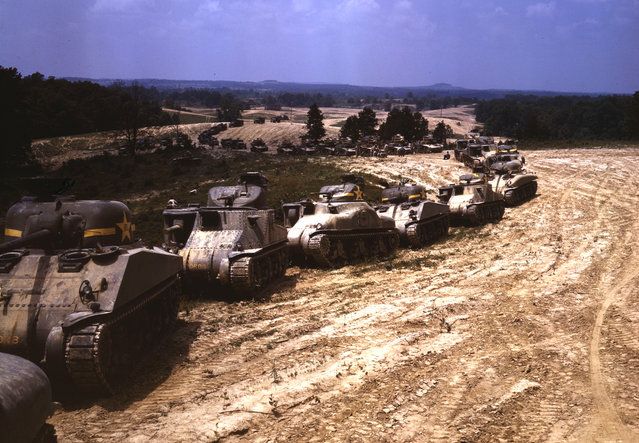 A parade of M-4 (General Sherman) and M-3 (General Grant) tanks in training maneuvers, at Ft. Knox, Kentucky. Note the lower design of the M-4, the larger gun in the turret and the two hatches in front of the turret. Photographed in June of 1942