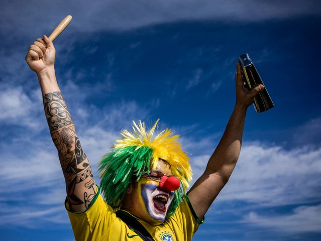 Brazil: Brazilian fan screams as he supports his team. (Photo by Zackary Canepari)