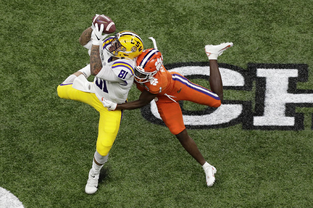 LSU tight end Thaddeus Moss catches a pass over Clemson cornerback Derion Kendrick during the first half of a NCAA College Football Playoff national championship game Monday, January 13, 2020, in New Orleans. (Photo by Eric Gay/AP Photo)
