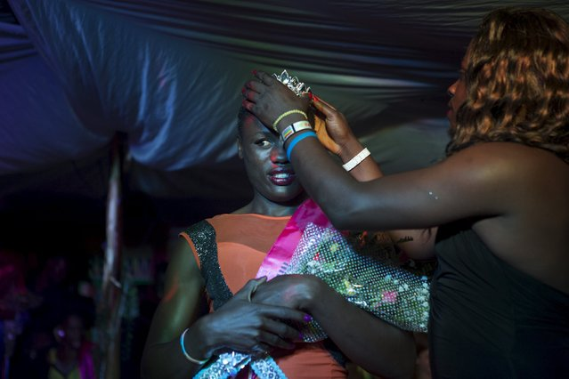 Mahad, who identifies as a trans-woman, is crowned after she was announced as the winner of the Miss Pride beauty contest at an undisclosed venue in Kampala, Uganda, August 7, 2015. (Photo by Edward Echwalu/Reuters)