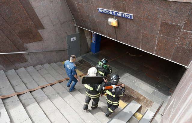 Members of the emergency services enter a metro station following an accident on the subway in Moscow July 15, 2014. (Photo by Sergei Karpukhin/Reuters)