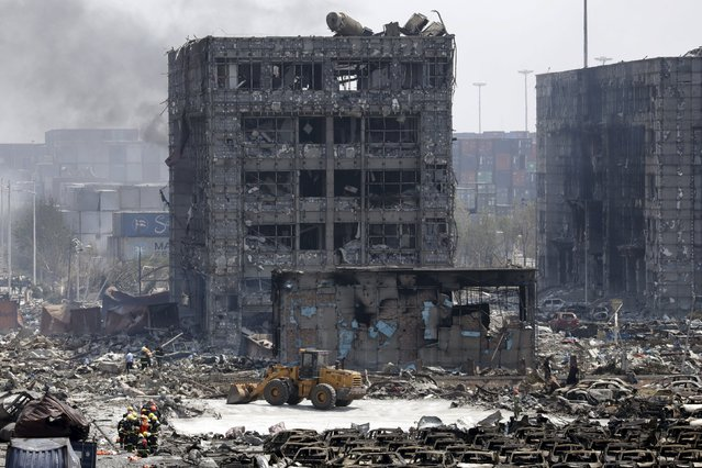 Damaged buildings and cars are seen near the site of the explosions at the Binhai new district, Tianjin, August 13, 2015. (Photo by Jason Lee/Reuters)