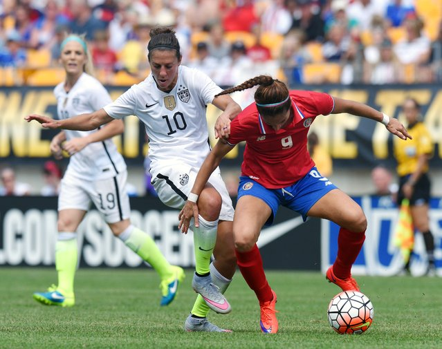 United States midfielder Carli Lloyd (10) battles for a ball against Costa Rica defender Carolina Venegas (9) during the first half of a women's friendly soccer match on Sunday, August 16, 2015, in Pittsburgh. (Photo by Don Wright/AP Photo)