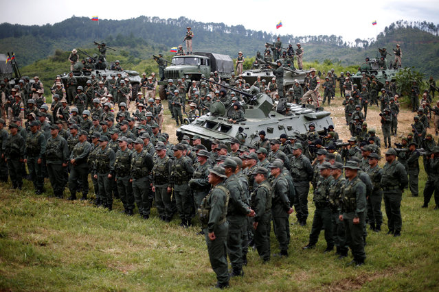 Members of the National Bolivarian Armed Forces attend a news conference of Venezuela's Defense Minister Vladimir Padrino Lopez in Caracas, Venezuela August 14, 2017. (Photo by Andres Martinez Casares/Reuters)
