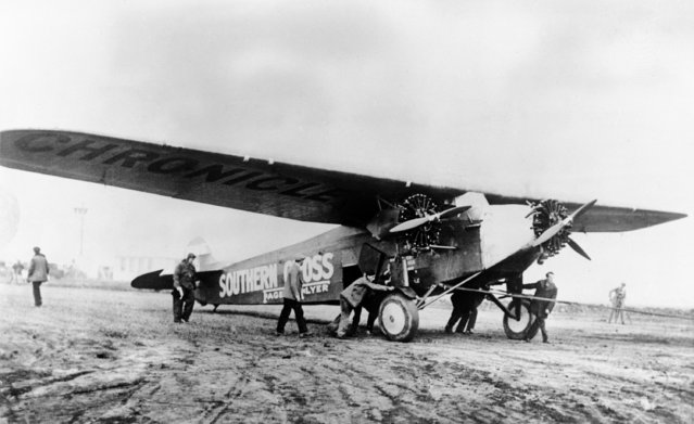 The Southern Cross being towed out onto the airfield at Oakland, Ca., on June 8, 1928, before setting off to Australia. Captain Charles Kingsford Smith and Charles Ulm will be attempting the 7,500 mile record flight. (Photo by AP Photo)