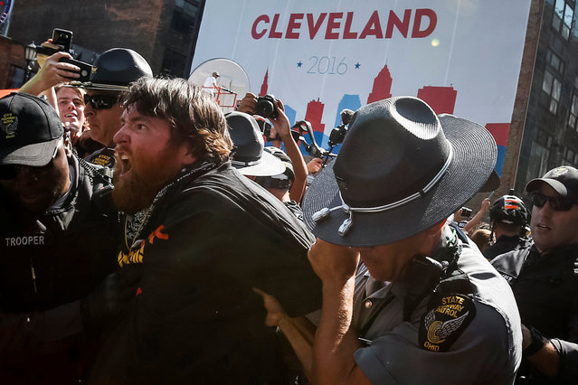 A supporter of the Revolutionary Communist Party is arrested by police after assisting other members with burning a U.S. flag outside the gates of the Quicken Loans Arena, the site for the Republican National Convention in Ohio, U.S., July 20, 2016. (Photo by Adrees Latif/Reuters)