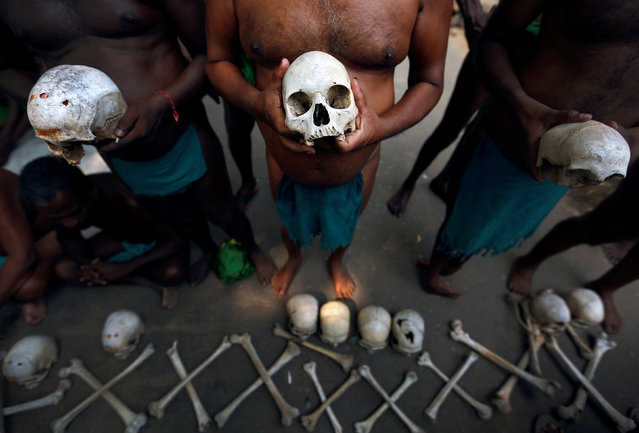 Farmers from the southern state of Tamil Nadu display skulls which they claim are the remains of Tamil farmers who have committed suicide, during a protest demanding good rates for their crops and crop insurance scheme from the government, in New Delhi, India, September 13, 2017. (Photo by Cathal McNaughton/Reuters)