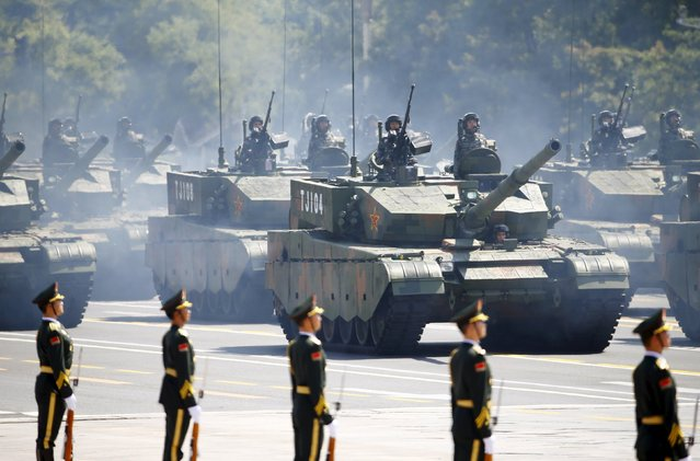 Soldiers of China's People's Liberation Army (PLA) stand in armored vehicles during the military parade to mark the 70th anniversary of the end of World War Two, in Beijing, China, September 3, 2015. (Photo by Damir Sagolj/Reuters)