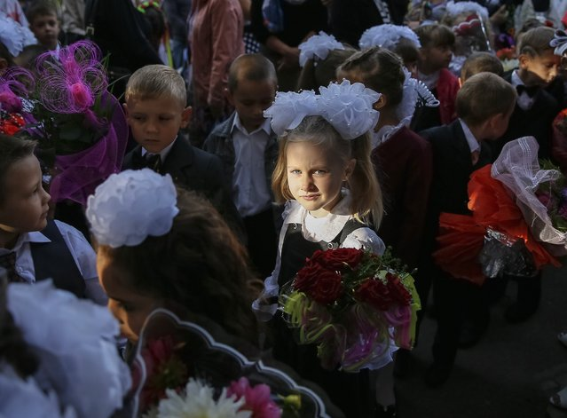 First graders wait for a festive ceremony to mark the start of another school year in Slaviansk, September 1, 2014. (Photo by Gleb Garanich/Reuters)