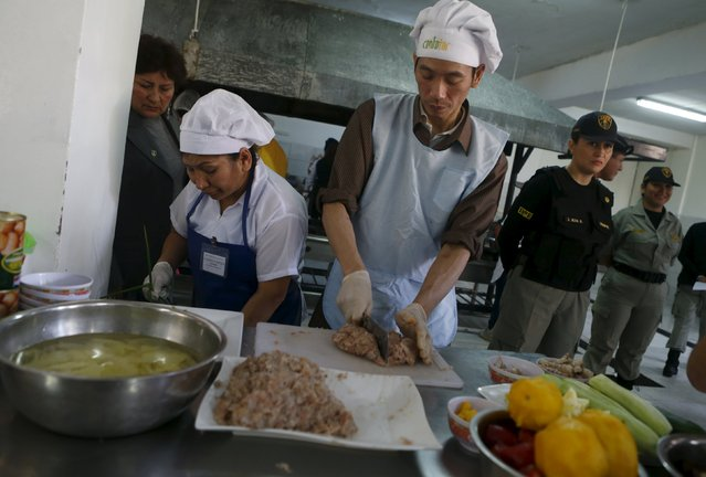 Chinese inmate Ye-Yaochi cooks food during a culinary competition at the Santa Monica female prison in Lima, September 10, 2015. (Photo by Mariana Bazo/Reuters)