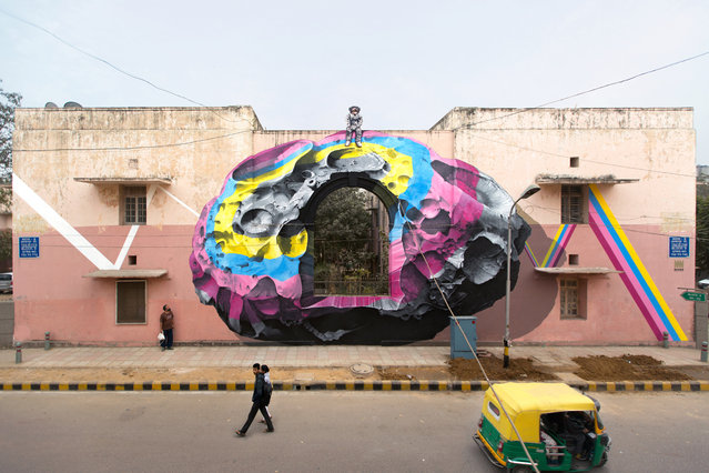 """""""See through / see beyond"""" mural painting and installation for St+Art India in New Delhi in January 2016. (Photo by NeverCrew/The Huffington Post)"""