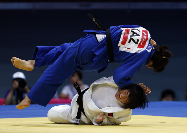 North Korea's Kim Jong Sun competes with Kazakhstan's Dinara Kudarova in their women's team bronze medal judo contest at Dowon Gymnasium during the 17th Asian Games in Incheon September 23, 2014. (Photo by Issei Kato/Reuters)
