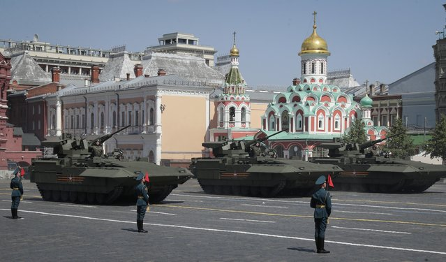 Russian army tanks roll toward Red Square during the Victory Day military parade marking the 75th anniversary of the Nazi defeat in Moscow, Russia, Wednesday, June 24, 2020.  The Victory Day parade normally is held on May 9, the nation's most important secular holiday, but this year it was postponed due to the coronavirus pandemic. (Photo by Pavel Golovkin/AP Photo/Pool)
