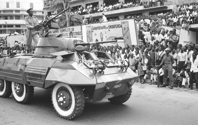 In this June 30, 1961 file photo, Congo celebrates the first anniversary of independence from Belgium with a large military parade in Leopoldville, the capital before it was later renamed in 1966 to Kinshasa, in Congo. On Tuesday, June 30, 2020 Congo is marking the 60th anniversary of achieving independence from the colonial rule of Belgium. (Photo by Horst Faas/AP Photo/File)