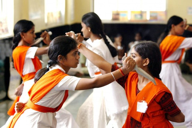 Women activists of the Vishwa Hindu Parishad or World Hindu Council take part in a class on fighting with weapons at a summer training camp in Bombay May 17, 2003. (Photo by Sherwin Crasto/Reuters)