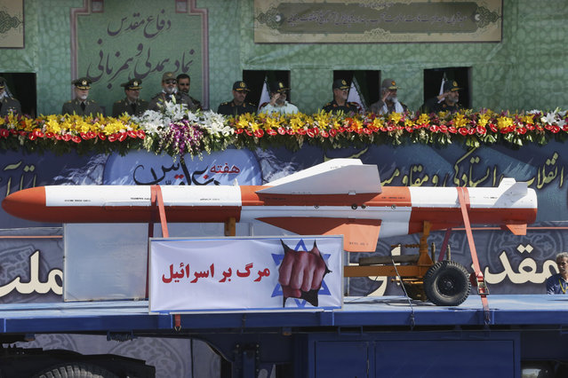 "Iranian armed forces commanders review weapons as an anti-Israel banner which reads in Persian: ""death to Israel"" is placed on the truck in a military parade marking the 35th anniversary of Iraq's 1980 invasion of Iran, in front of the shrine of late revolutionary founder Ayatollah Khomeini, just outside Tehran, Iran, Tuesday, September 22, 2015. (Photo by Vahid Salemi/AP Photo)"
