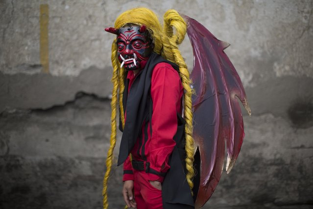 Bryan Gonzalez, 14, poses for a portrait in his devil costume at a procession symbolizing the fight between good and evil that celebrates the Virgin of the Immaculate Conception in Ciudad Vieja, Guatemala, Thursday, December 7, 2017. The Old City holds their town's days-long annual fair in honor of their patron saint, the Virgin of the Immaculate Conception, whose official feast day is Dec. 8. (Photo by Luis Soto/AP Photo)