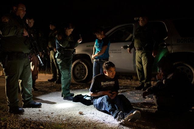 A man from Guatemala is apprehended by border patrol agents south of Granjeno, Texas. (Photo by Kirsten Luce/Getty Images)