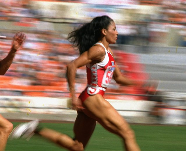 U.S. sprinter Florence Griffith Joyner of Los Angeles strides to a world record in a semifinal heat of the Olympic women's 200-meter dash in Seoul Thursday, September 29, 1988. Joyner's time of 21.56 seconds claimed the record and moved her into the finals in the event. (Photo by Lennox McLendon/AP Photo)