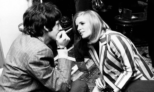 Linda Eastman talks to Paul McCartney at the launch of the Beatles album Sgt Pepper's Lonely Hearts Club Band in May 1967 in London, England. The couple married two years later. (Photo by John Pratt/Getty Images)