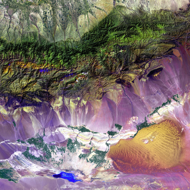 Bogda Mountains. The Turpan Depression, nestled at the foot of China's Bogda Mountains, is a strange mix of salt lakes and sand dunes. It is one of the few landscapes in the world that lies below sea level. This image was acquired by Landsat 7's Enhanced Thematic Mapper plus (ETM+) sensor. (Photo by NASA/GSFC/USGS EROS Data Center)