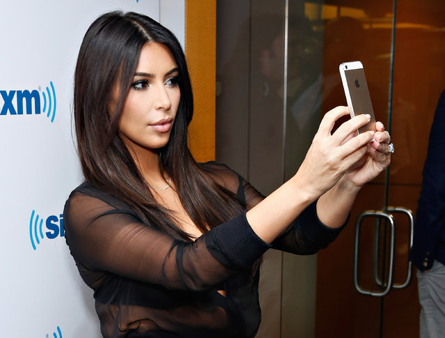TV personality Kim Kardashian takes a selfie at the SiriusXM Studios on August 11, 2014 in New York City.  (Photo by Cindy Ord/Getty Images)
