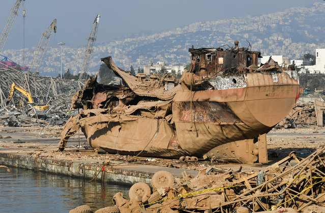 A picture shows a blown up ship which was thrown on the land at Beirut port on August 7, 2020, three days after a massive blast there shook the Lebanese capital. Rescuers combed through the rubble of Beirut port today in a search for survivors watched breathlessly by relatives of the missing, after an investigation. (Photo by Joseph Eid/AFP Photo)