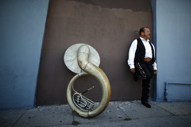 Mariachi musician Moises Rivera, 60, waits for a gig in the Boyle Heights area of Los Angeles, home to many Mexican and Central American migrants, in California August 9, 2014. (Photo by Lucy Nicholson/Reuters)