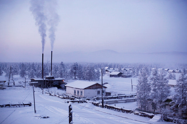 """The village of Oymyakon, with its heating plant chugging coal smoke into the freezing air. It was dubbed """"The Pole Of Cold"""" after recording a temperature of minus 71.2° degrees Celsius in 1933. The record freeze was just a few degrees shy of the minus 78.5°C temperature of dry ice. (Photo by Amos Chapple/Courtesy Images/RFE/RL)"""