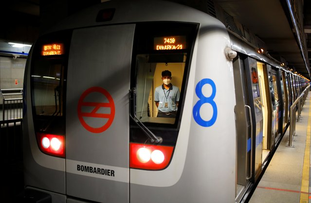 A worker stands inside a train at a Delhi Metro station ahead of the restart of its operations, amidst the spread of coronavirus disease (COVID-19), in New Delhi, India, September 3, 2020. (Photo by Adnan Abidi/Reuters)